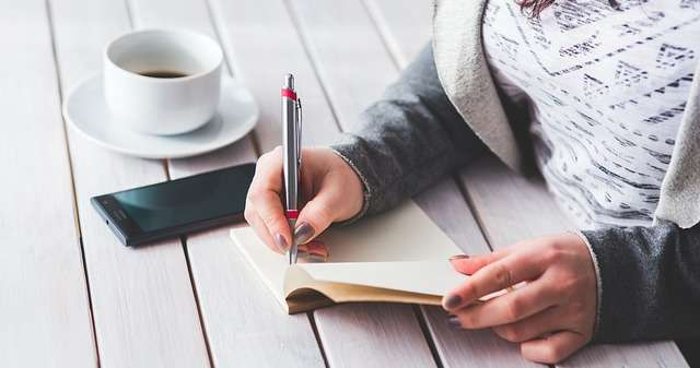 woman journaling her life story